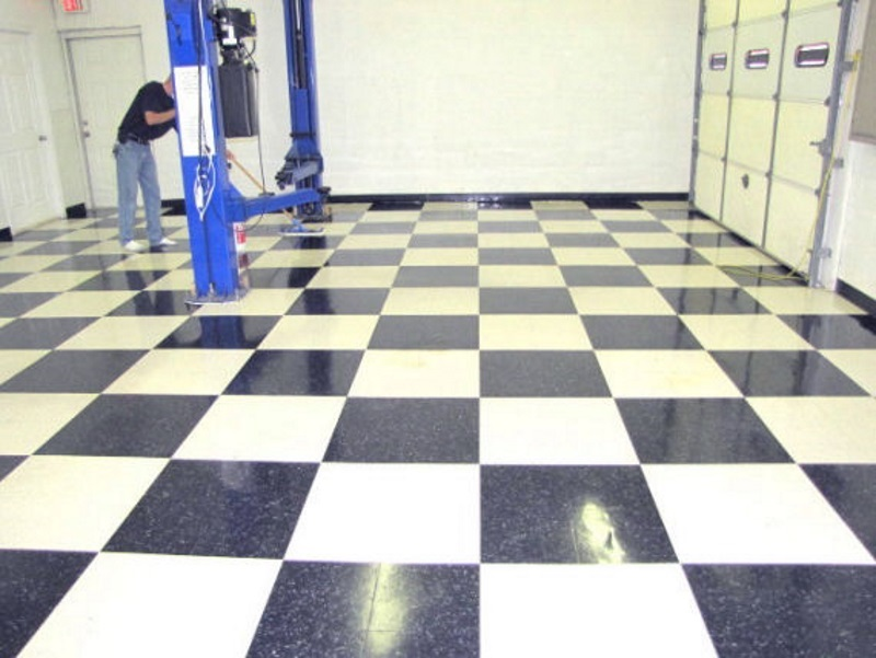 Automotive shop in O'Fallon, MO after cleaning. Black and white tiles now.