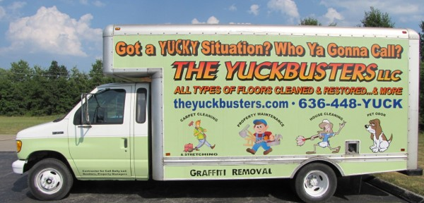 Service truck that has The YuckBusters logo